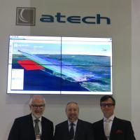 ATECH apresenta inovações que interligam novas tecnologias com aplicações de defesa. Claudio Carvas, Diretor Negócios Corporativos, esq, Edson Mallaco, Presidente, Denis Belaguer , Marketing Estratégico Foto - DefesaNet