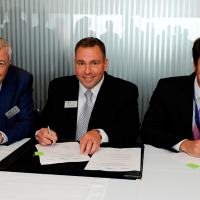 A picture to illustrate this signature is enclosed: Right: Matthieu Louvot, senior vice president, Customer Services, Airbus Helicopters, Center: Troy Brunk, vice president and general manager, Airborne Solutions, Rockwell Collins - Left: Declan O'Shea, president and CEO, Vector Aerospace Corporation.