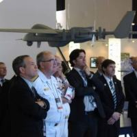 Miki Bar, president of IAI Brazil (left), along with Admiral Leal Ferreira, Commander of the Brazilian Navy, and IAI Brazil's CEO Henrique Gomes.