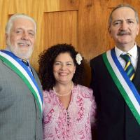 Mrs Perpetua Almeida between the former Brazilian Defense Minister, left, and the new Minister Mr Aldo Rebelo. Photo - MOD Brazil