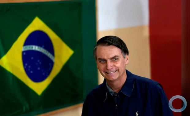 Jair Bolsonaro, far-right lawmaker and presidential candidate of the Social Liberal Party (PSL), arrives to cast his vote in Rio de Janeiro, Brazil October 7, 2018. REUTERS/Ricardo Moraes
