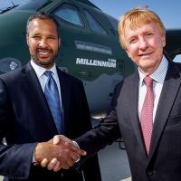 Mark Allen Boeing Brasil and Jackson Schneider shake hands with the C-390 Millennium in the back Photo EMBRAER