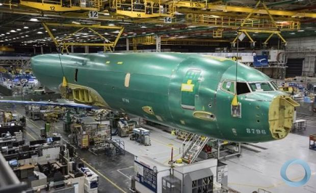Norway's first P-8A Poseidon aircraft is moved from a rail car through the air to the first step of the assembly process, the Fuselage Systems Installation tool, in Renton, Washington. (Boeing photo)