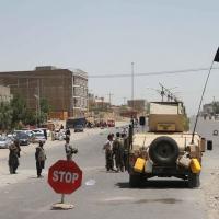 Exército afegão e milícias patrulhando as ruas de Herat em agosto de 2021. Keystone/Jalil Rezayee